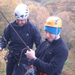 Chris and Matt abseiling above the Bowderstone, Borrowdale
